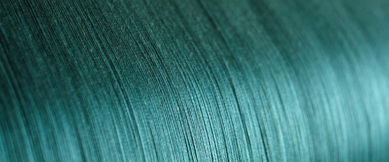 green-silk-on-a-warping-loom-of-a-textile-mill-silk-for-weaving-on-a-hand-loom-hand-made-silk